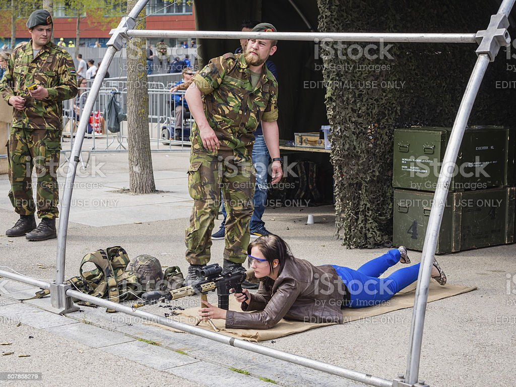 People play with weapons on Army Day stock photo