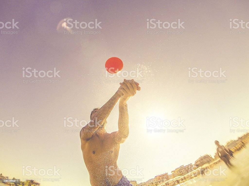 People playing and sea waves in the water stock photo