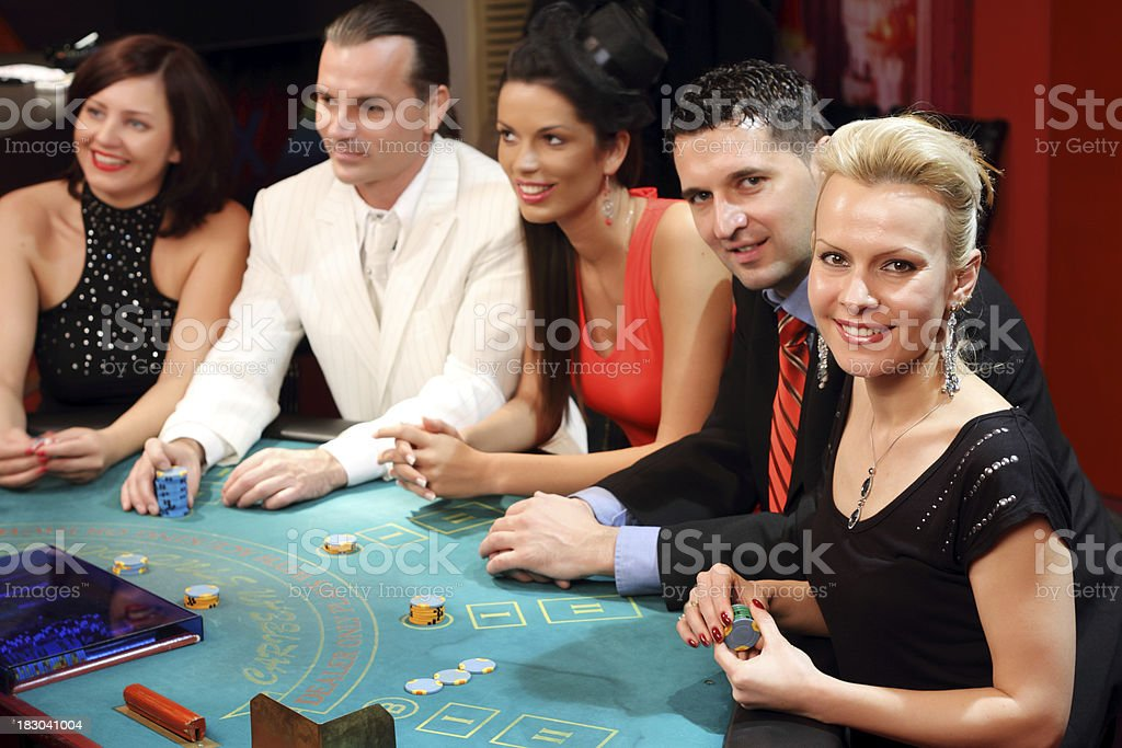 People playing at the Blackjack table in casino. stock photo
