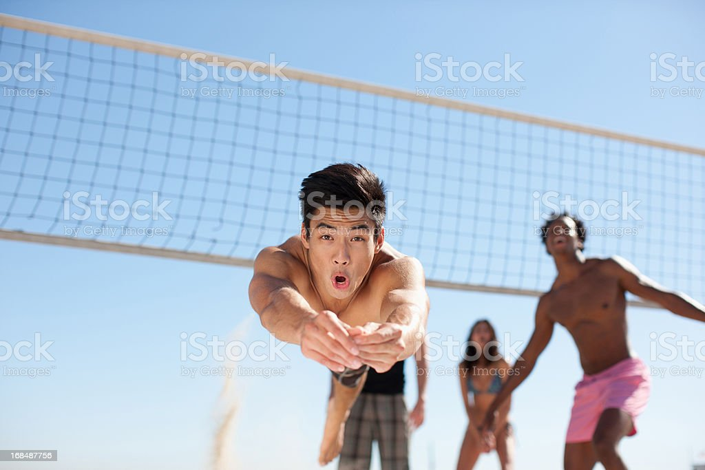 People playing beach volleyball royalty-free stock photo
