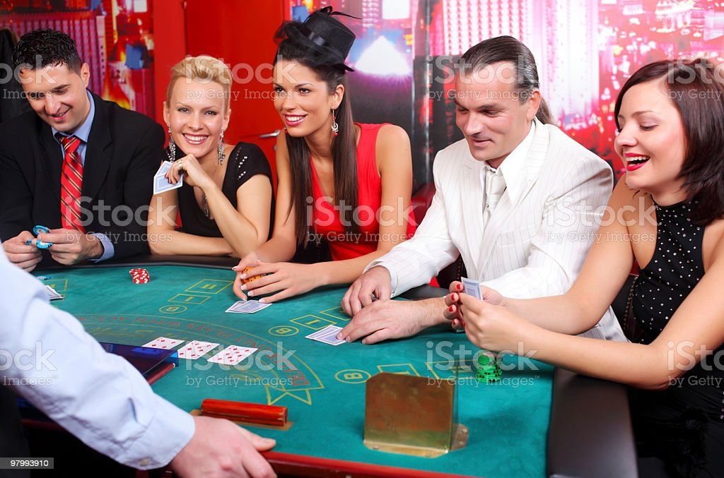 People playing Blackjacks in casino. royalty-free stock photo