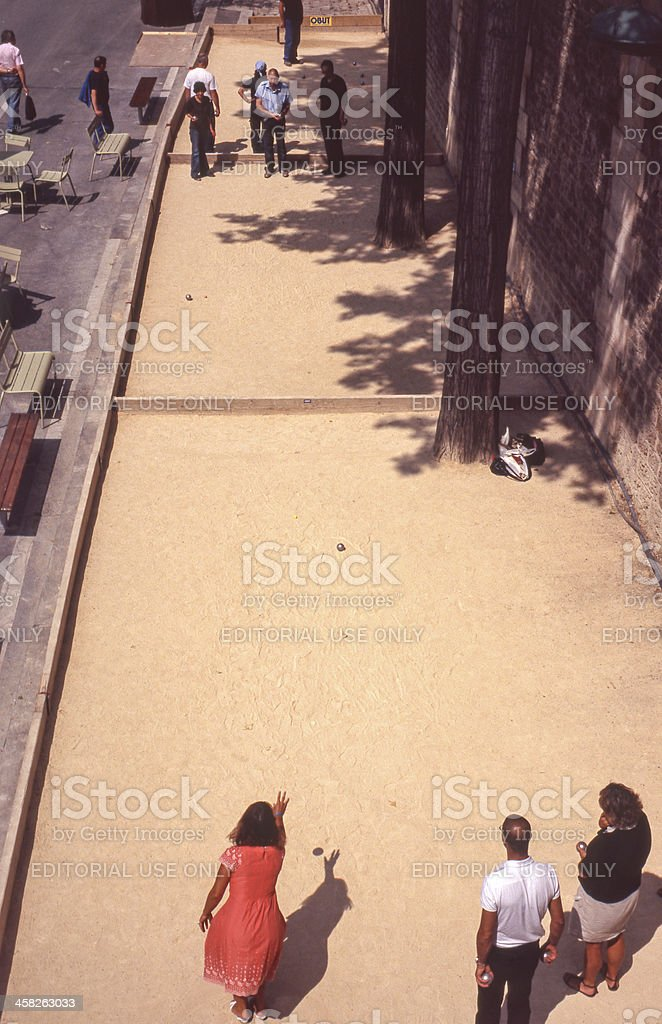 People playing boules in Paris royalty-free stock photo
