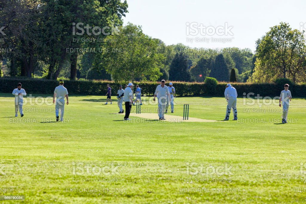 People playing Cricket in a park in Malahide, County Fingal, Ireland stock photo