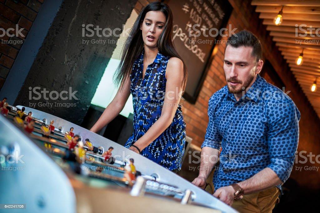 People playing foosball stock photo
