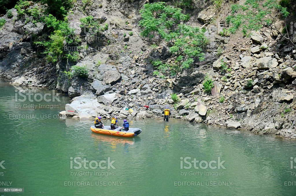 People playing inflatable rubber boat at Hozugawa River stock photo