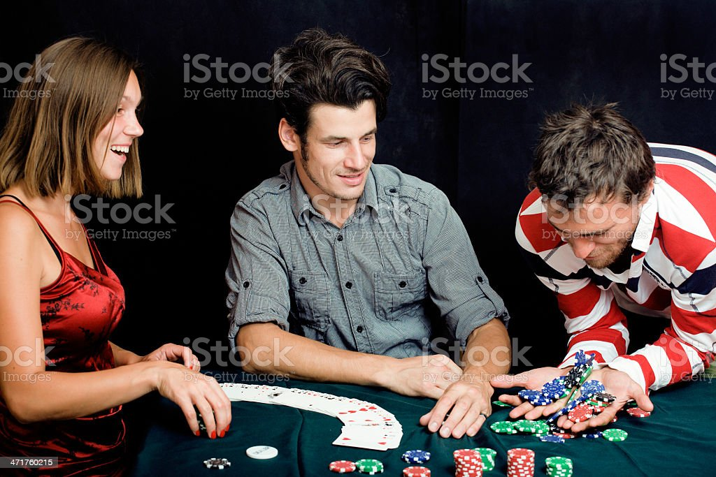 people playing poker royalty-free stock photo