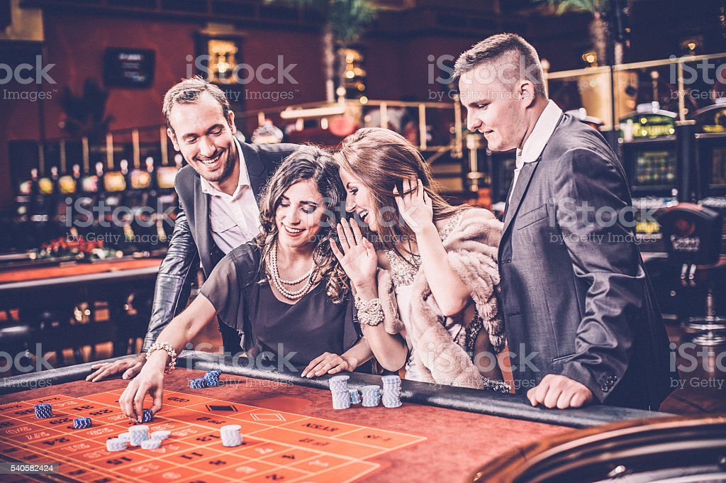 people playing roulette at the casino stock photo
