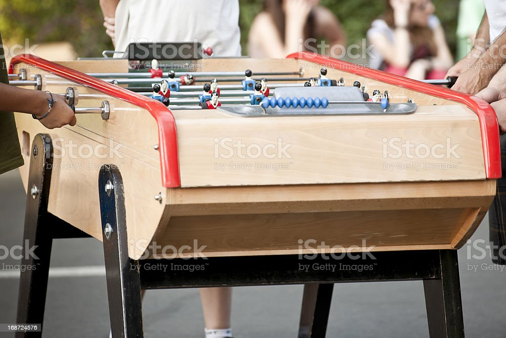 People playing table soccer. Pinball royalty-free stock photo