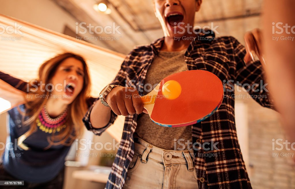 People playing table tennis at casual office. stock photo