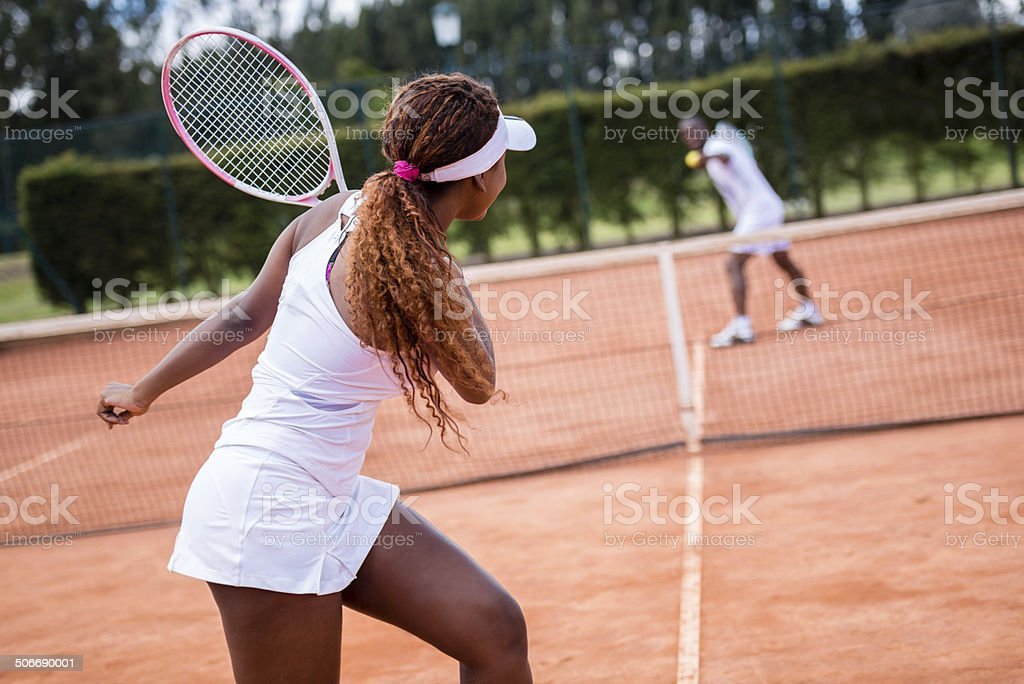People playing tennis stock photo