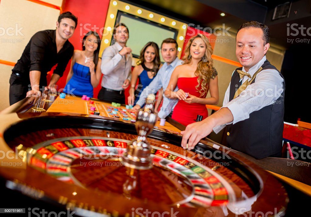 People playing the roulette stock photo