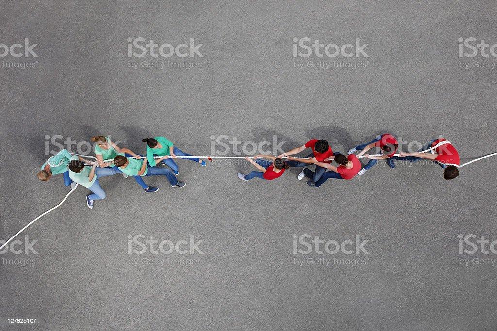 People playing tug of war stock photo
