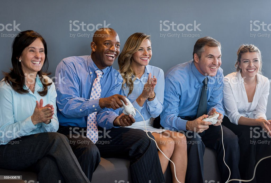 People playing video games at the office stock photo