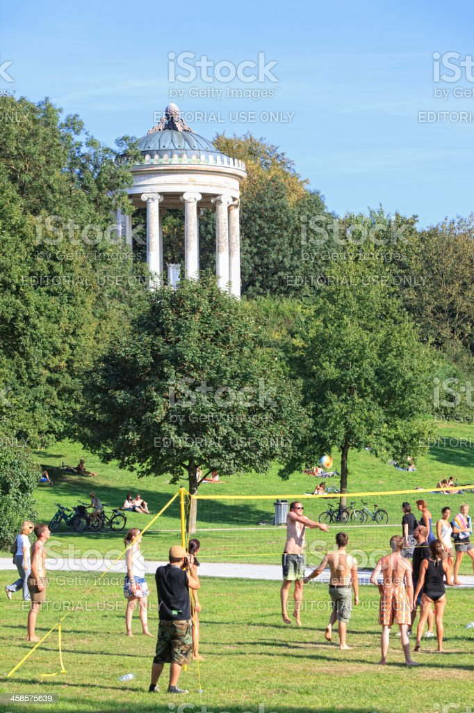 People playing volleyball at Monopteros in English Garden, Munich stock photo