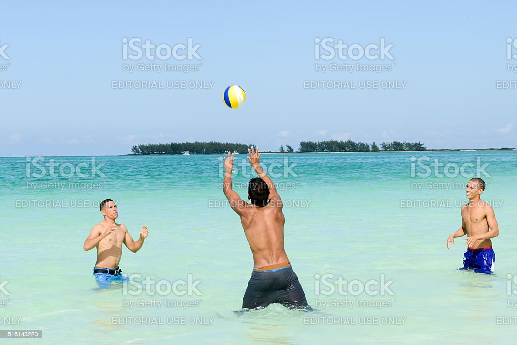 People playing volleyball in clear water of Cayo Guillermo beach stock photo