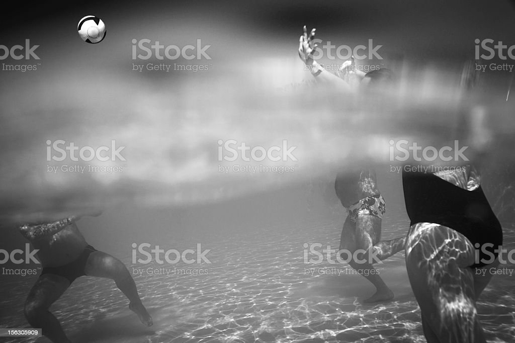 People Playing Volleyball In Water stock photo