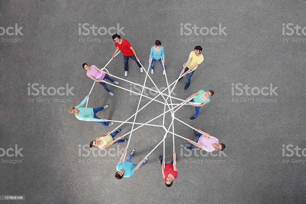 People playing with tangled string stock photo