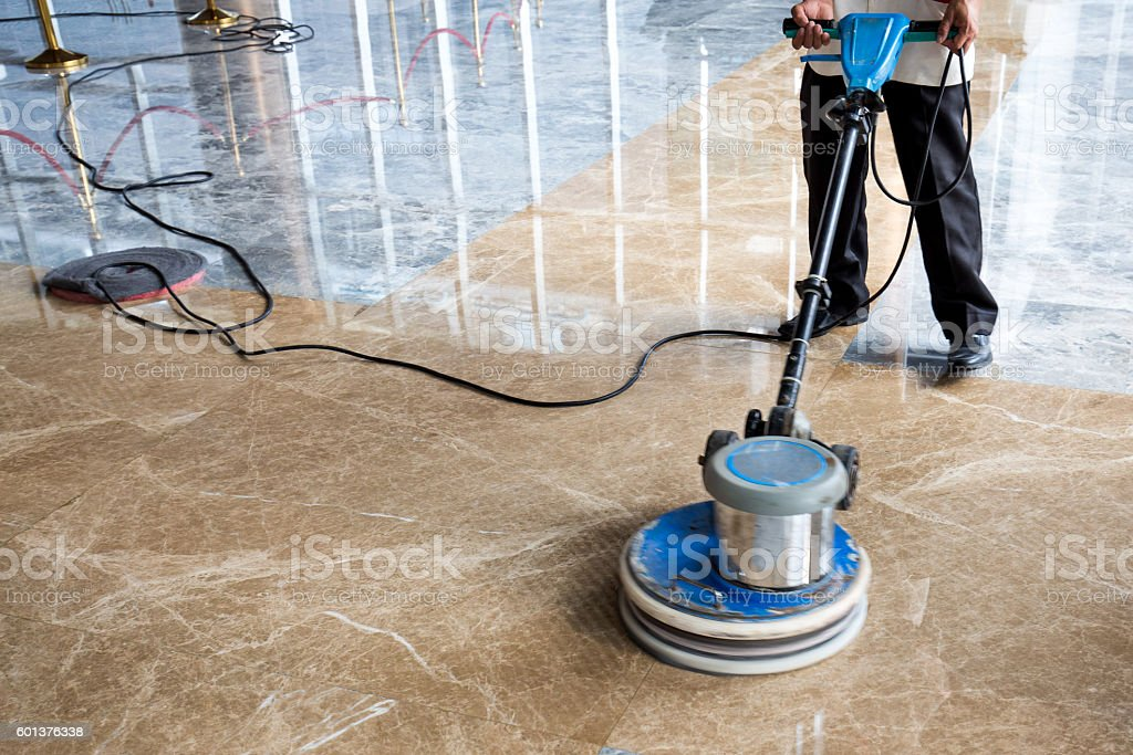 people polishes floor indoors stock photo