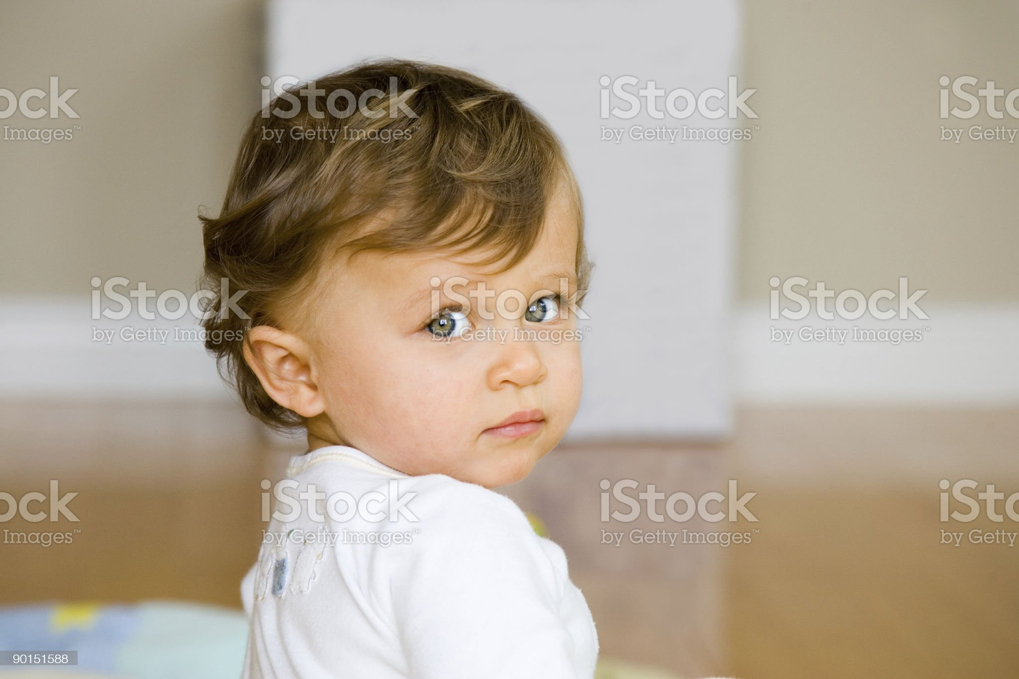 People - Portrait of baby girl looking over her shoulder royalty-free stock photo
