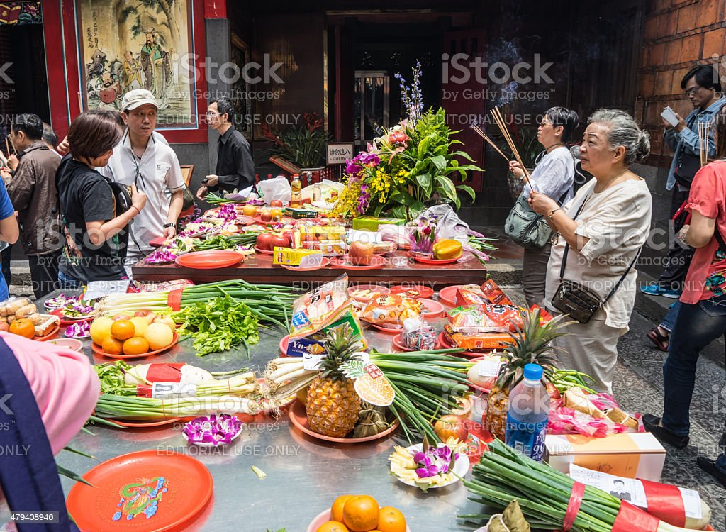 people pray and offering in Longshan temple in Taipei, Taiwan stock photo
