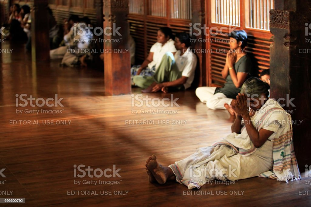 People pray in Buddhist church. Kandy, Sri Lanka stock photo