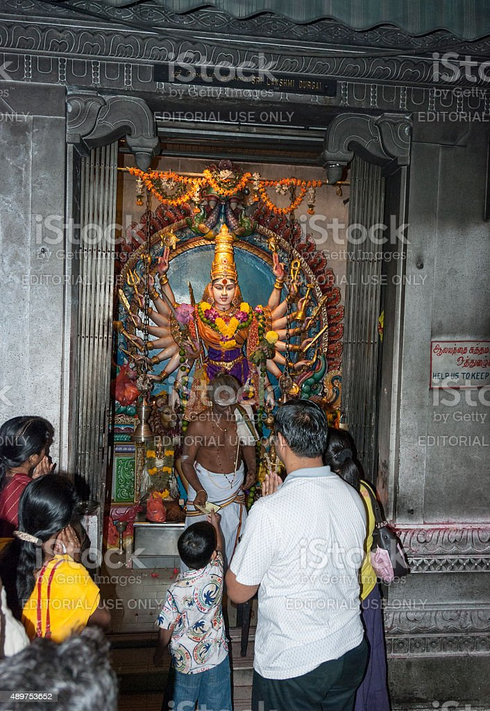 people pray in hindu temple stock photo