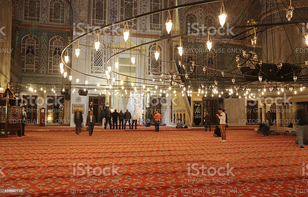People praying at Blue Mosque stock photo