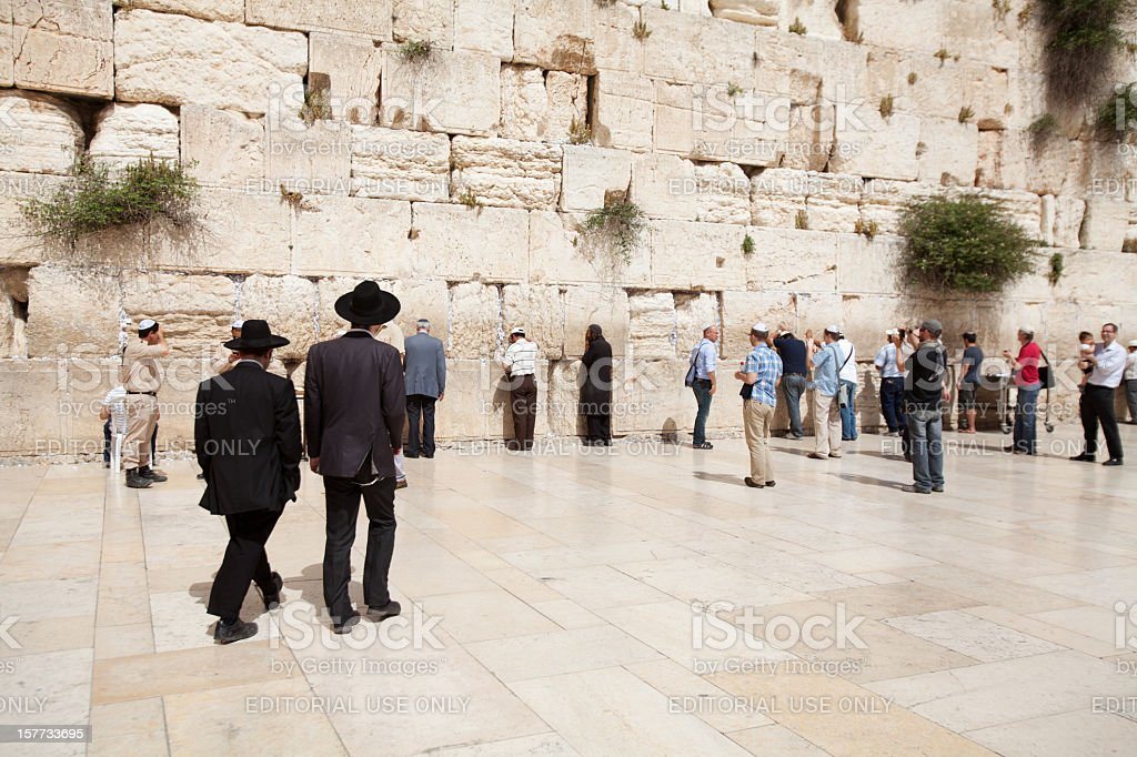 People praying at the Western Wall stock photo
