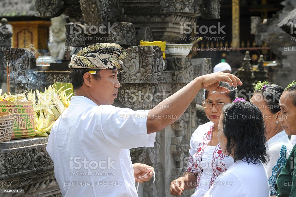 People praying at Tirta Empul Hindu Temple of Bali stock photo