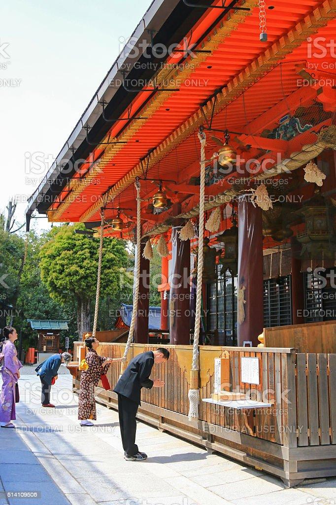 People praying at Yasaka Shrine, Shinto shrine in Kyoto, Japan stock photo