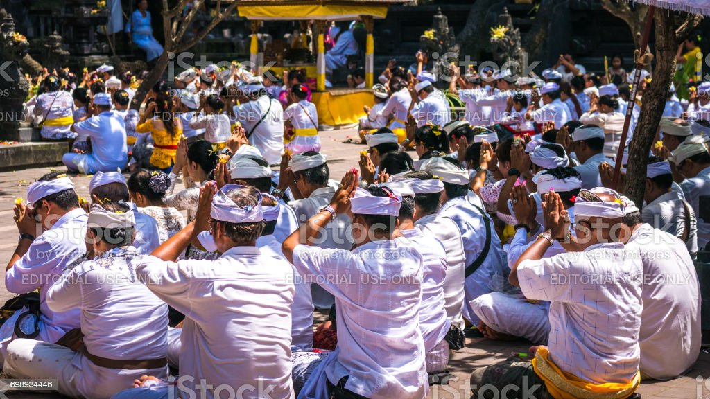 People praying during celebration Balinese ceremony at Pura Goa Lawah temple, Bali, Indonesia stock photo