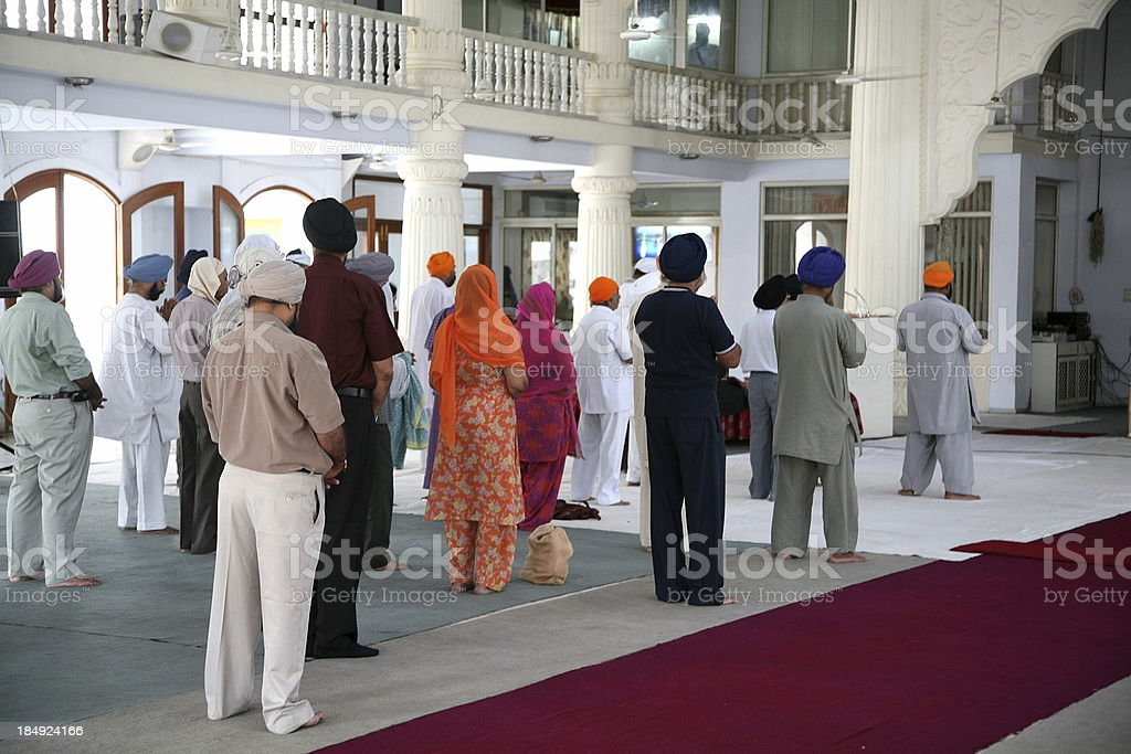 People praying in a Sikh temple royalty-free stock photo