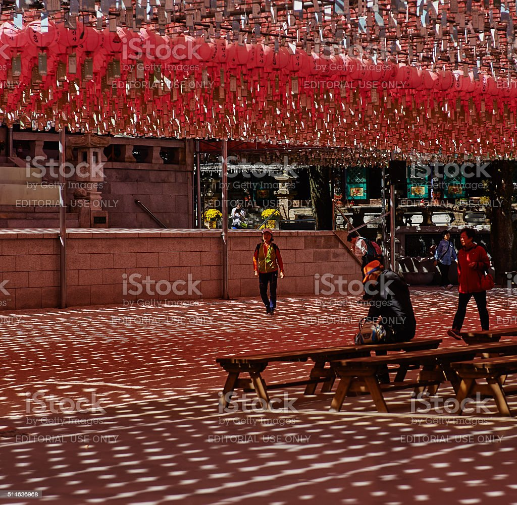 People praying in buddhist temple. stock photo