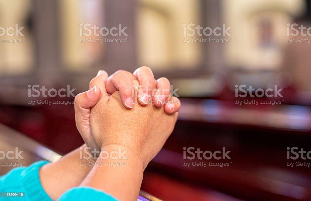 people praying in church stock photo
