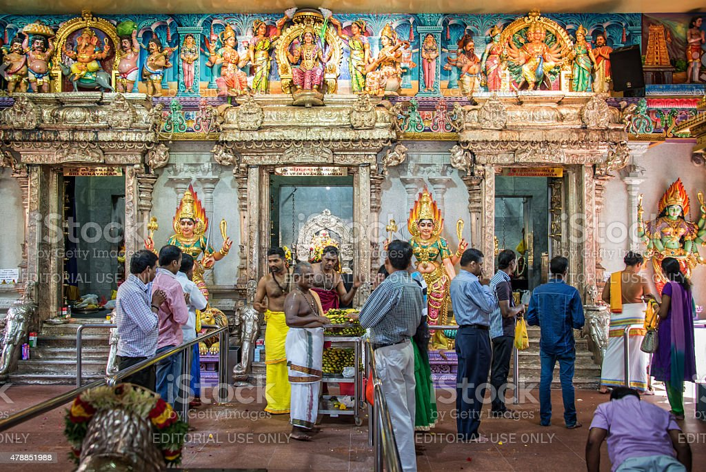 People praying inside Sri Veeramakaliamman Temple in Little India stock photo