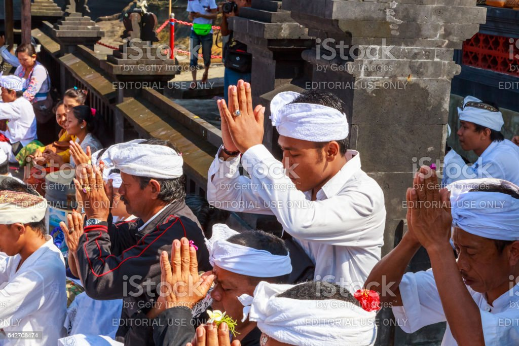 people praying on a Balinese 'Day of Silence' stock photo