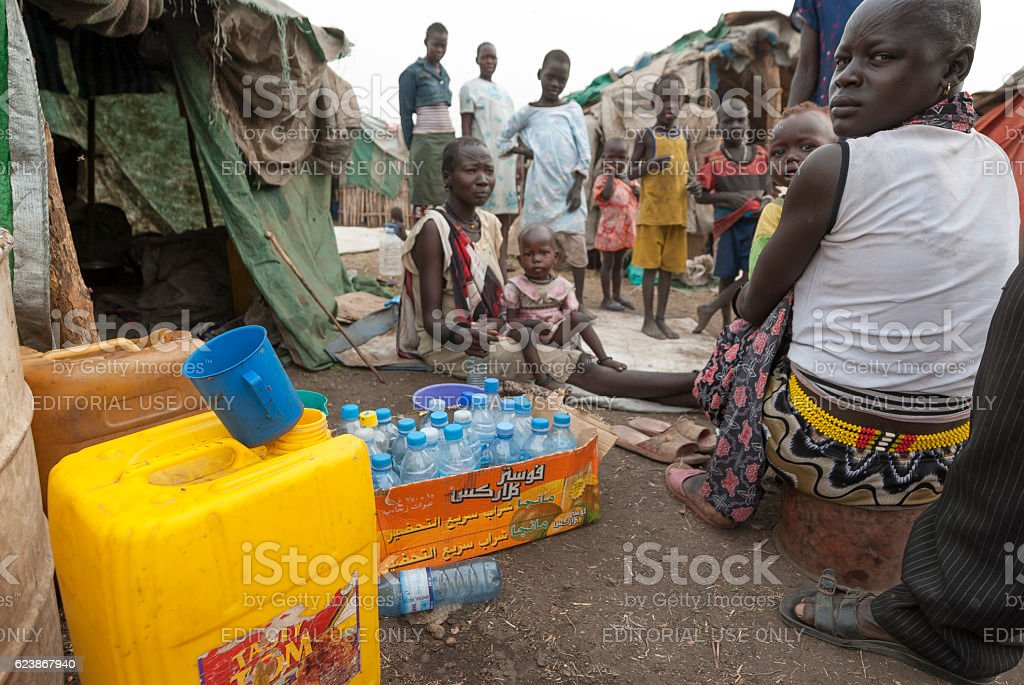 People prepare collect water in refugee camp, Juba, South Sudan. stock photo