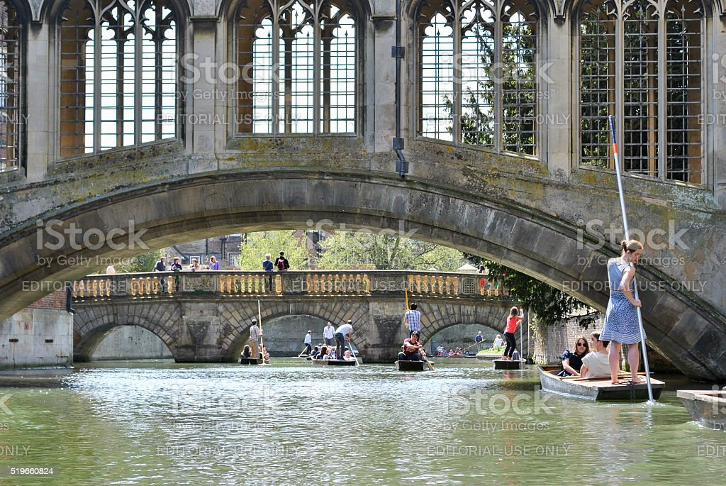 People punting in the river Cam in Cambridge stock photo