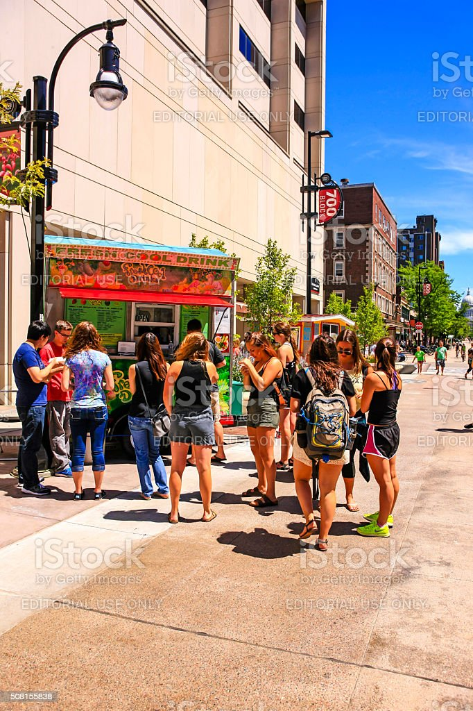 People purchasing cool drinks from a vender in Madison WI stock photo