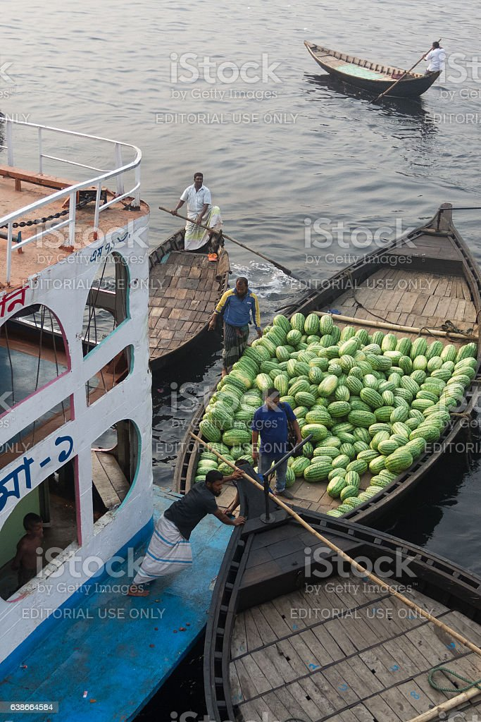 People pushing boats to clear it's way in the River stock photo