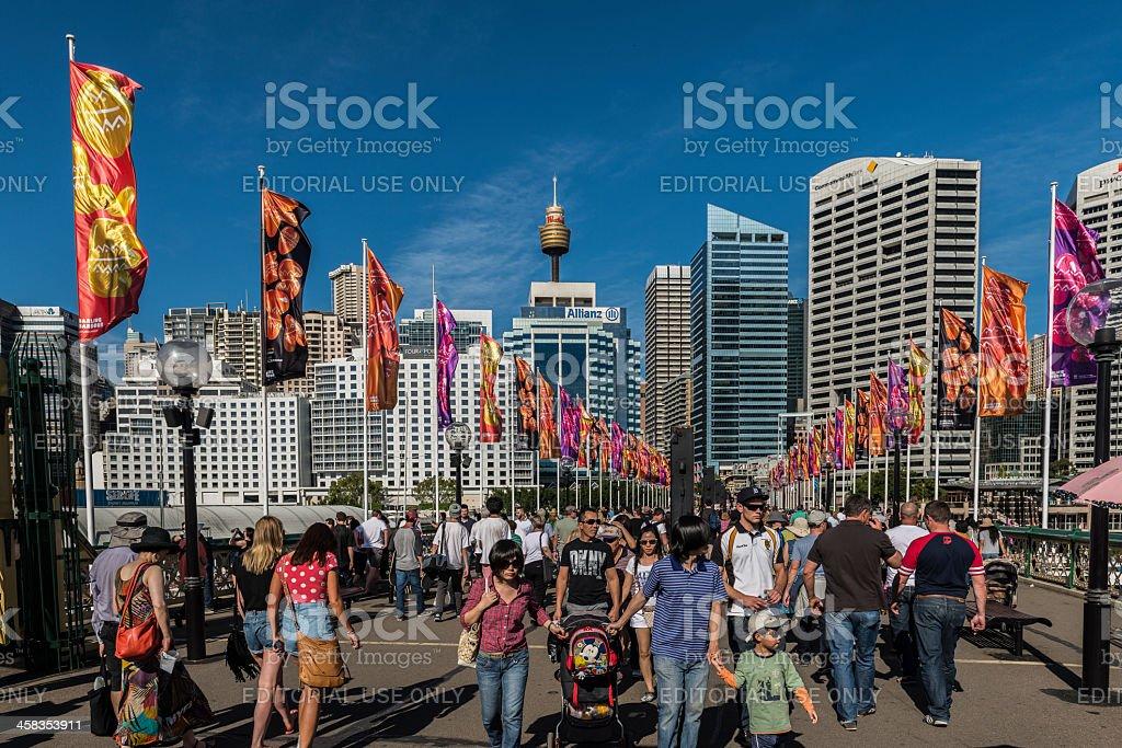 People, Pyrmont Bridge, Darling Harbour, Sydney, Australia. Flags, Blue Sky. stock photo