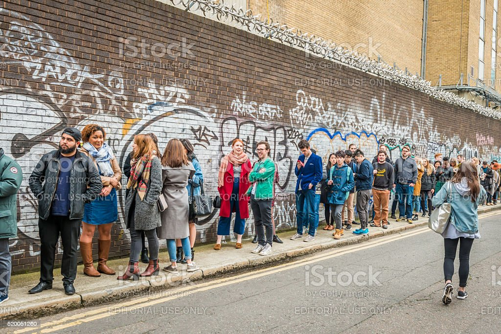 People queueing for entrance to The London Coffee Festival. stock photo