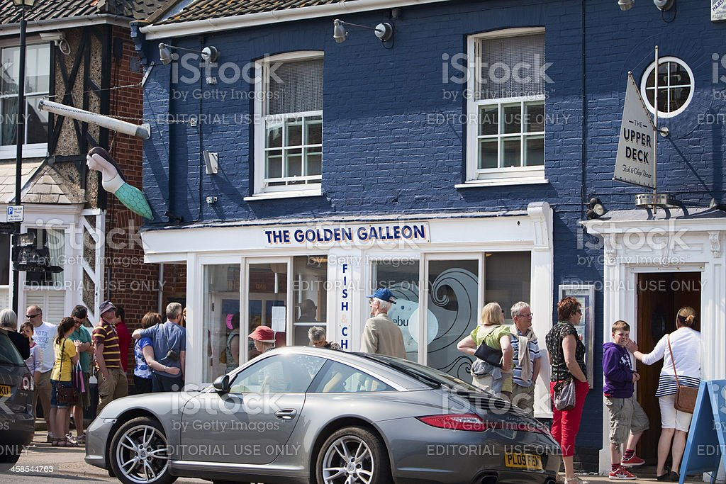 People queuing for fish and chips in Aldeburgh Suffolk stock photo