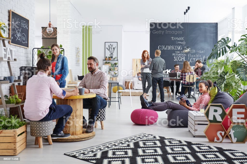 People realxing during lunch break stock photo