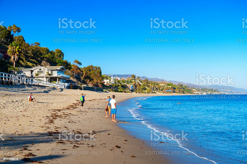 People Relax at Paradise Cove Beach in Malibu California USA stock photo