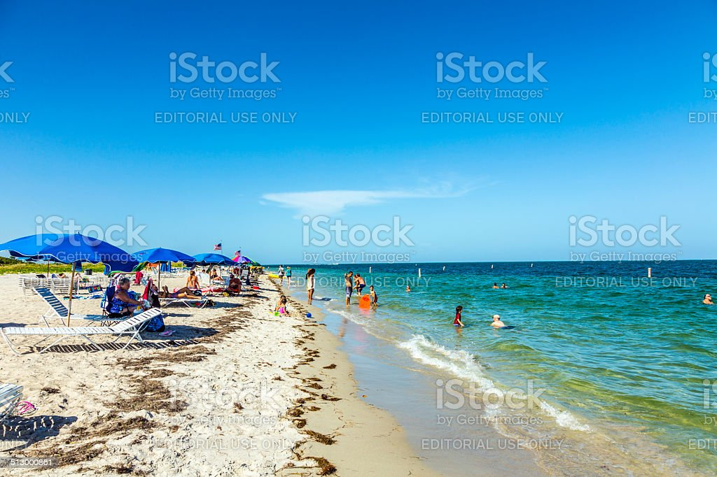 People relax at the Crandon Park beach stock photo