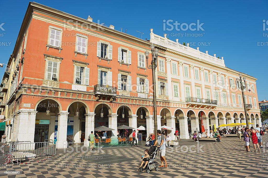 People relax at the Fontaine du Soleil in Nice, France. stock photo