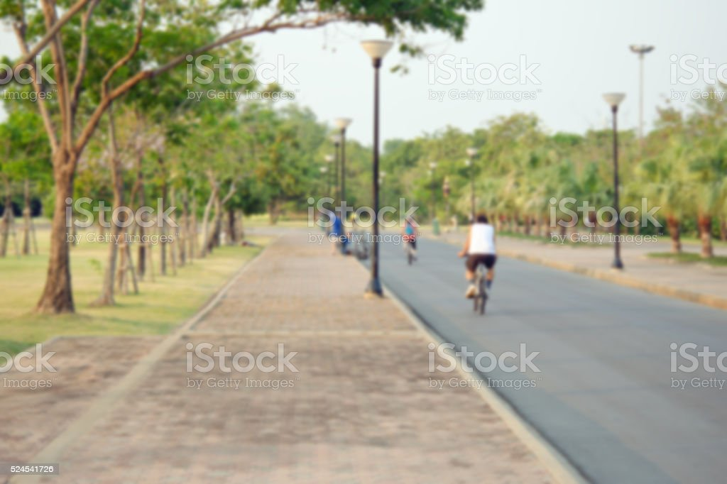 People relax in park and garden with blurred view stock photo