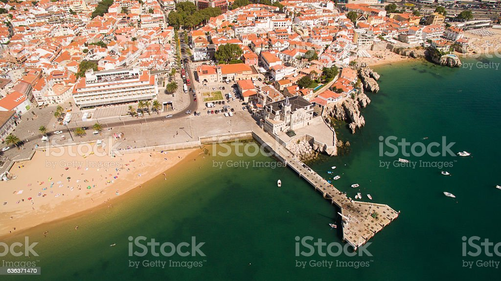 People relax on the beautiful beaches of Cascais Portugal aerial stock photo