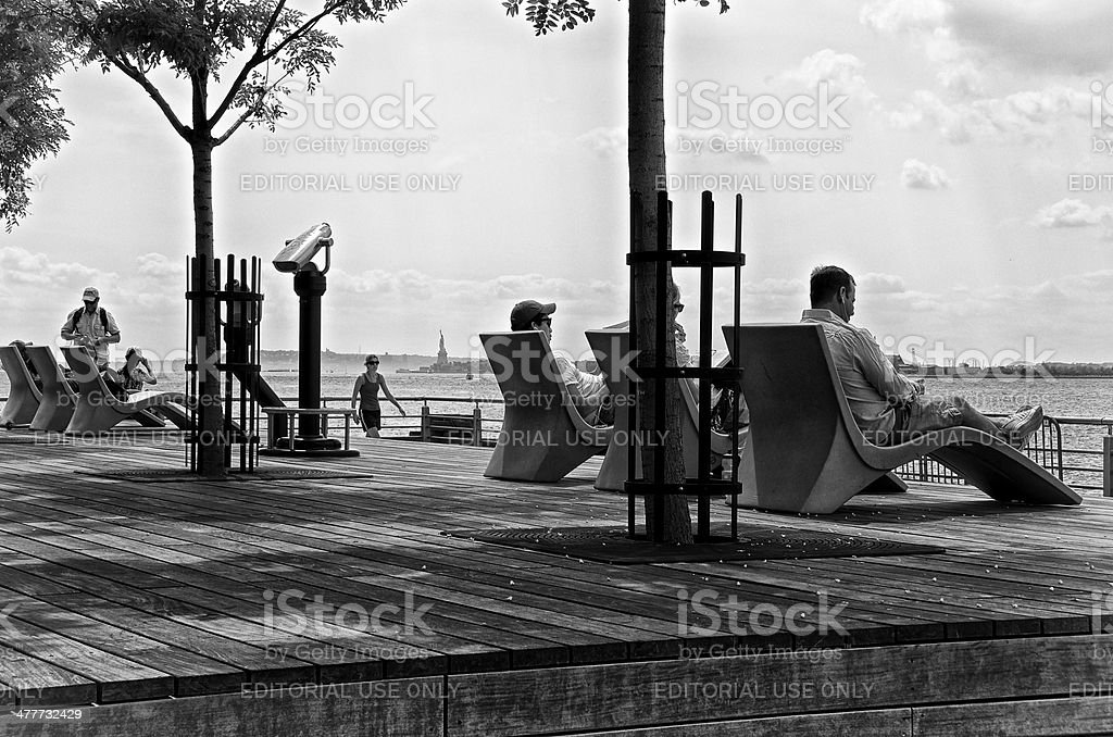 People relaxing along Hudson River pier, Lower Manhattan, NYC royalty-free stock photo